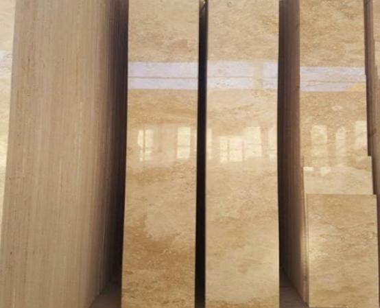 اجرای نمای ساختمان . اجرای نمای سنگ تراورتن ساختمان